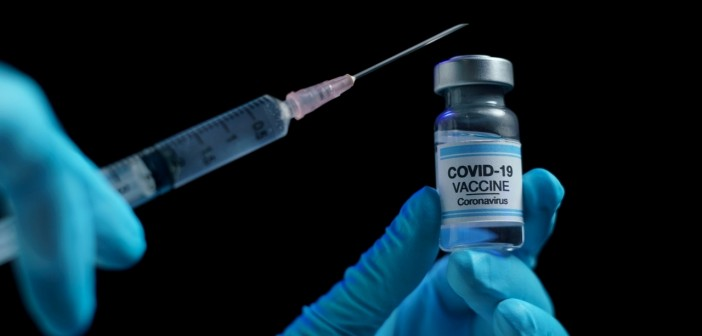 Hand in blue glove holding vaccine and syringe injection for pre